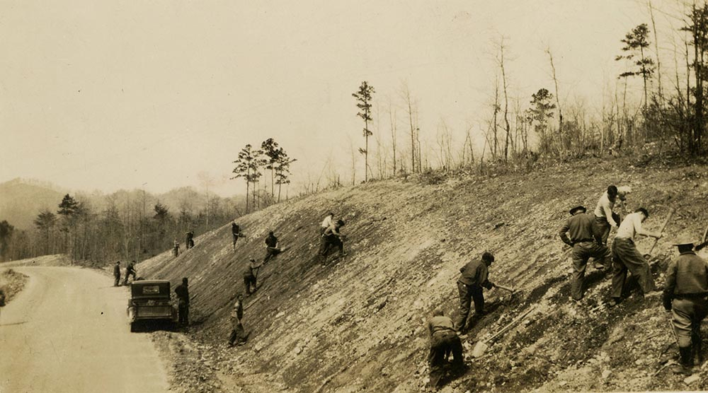 The Civilian Conservation Corps preparing a slope for seeding and planting