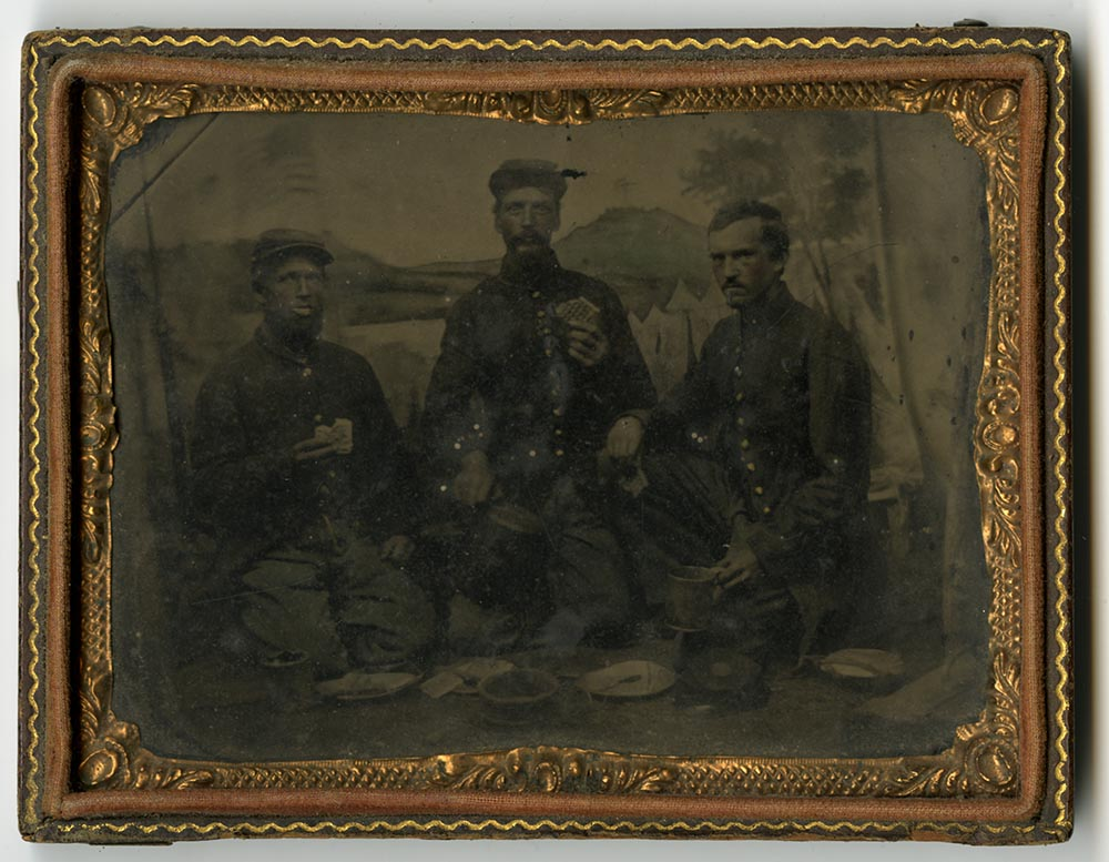 Tintype of Private Milo Stone and two soldiers eating hardtack