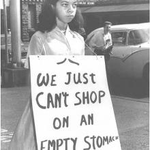 Photo of girl holding a civil rights sign